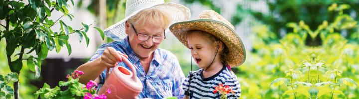 grandmother-granddaughter-watering-plants_1.jpg
